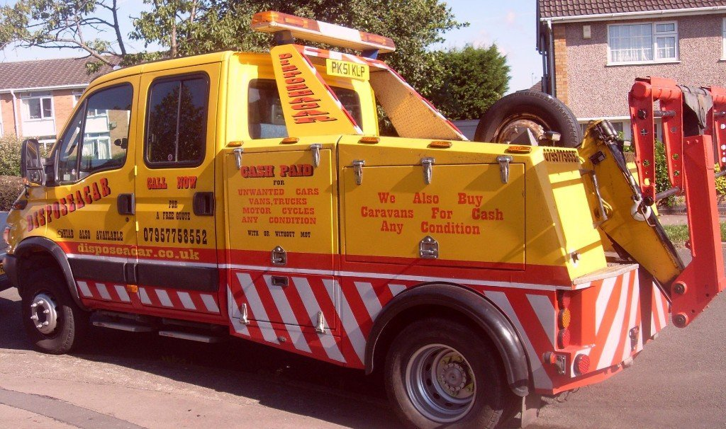 Disposeacar pick up truck in yellow and red