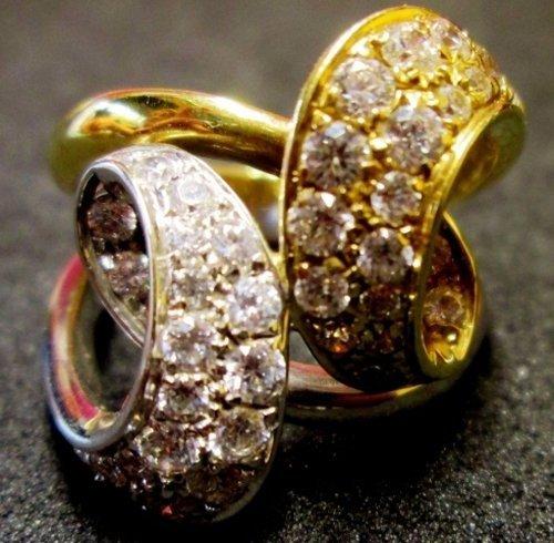 anello d'oro bianco e giallo con diamanti