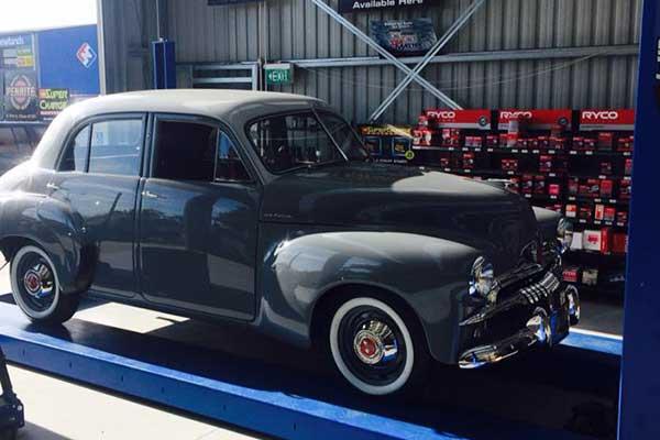 Grey color car on hydrolics