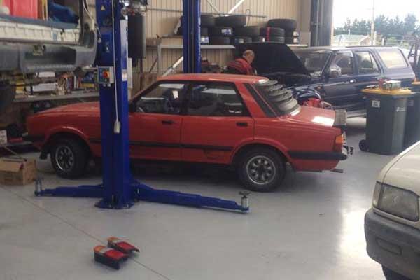 Red car in garage