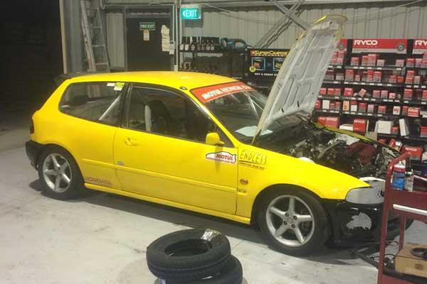Yellow car in garage for repair