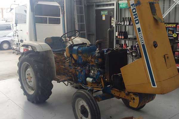 Yellow tractor for repair
