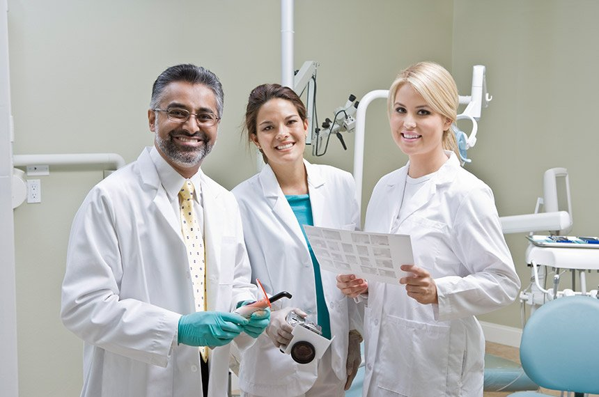 three dentists in an office