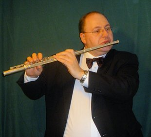 Mark playing a flute