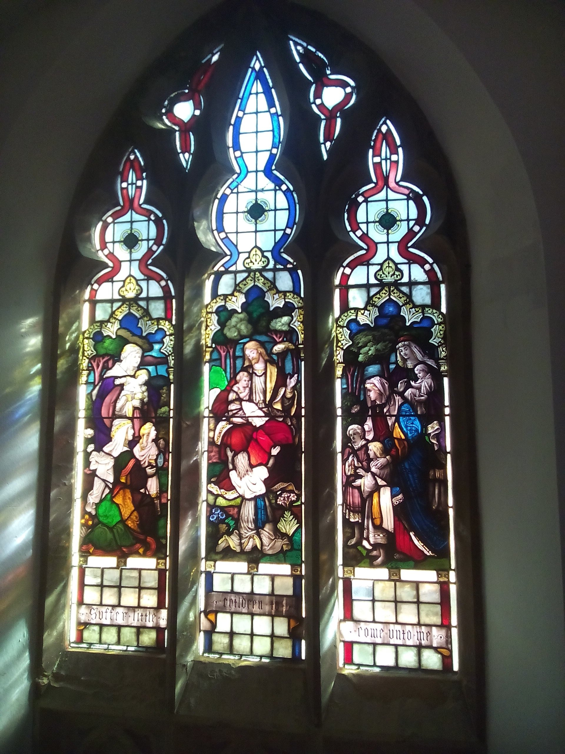 fully restored stained glass window depicting saints