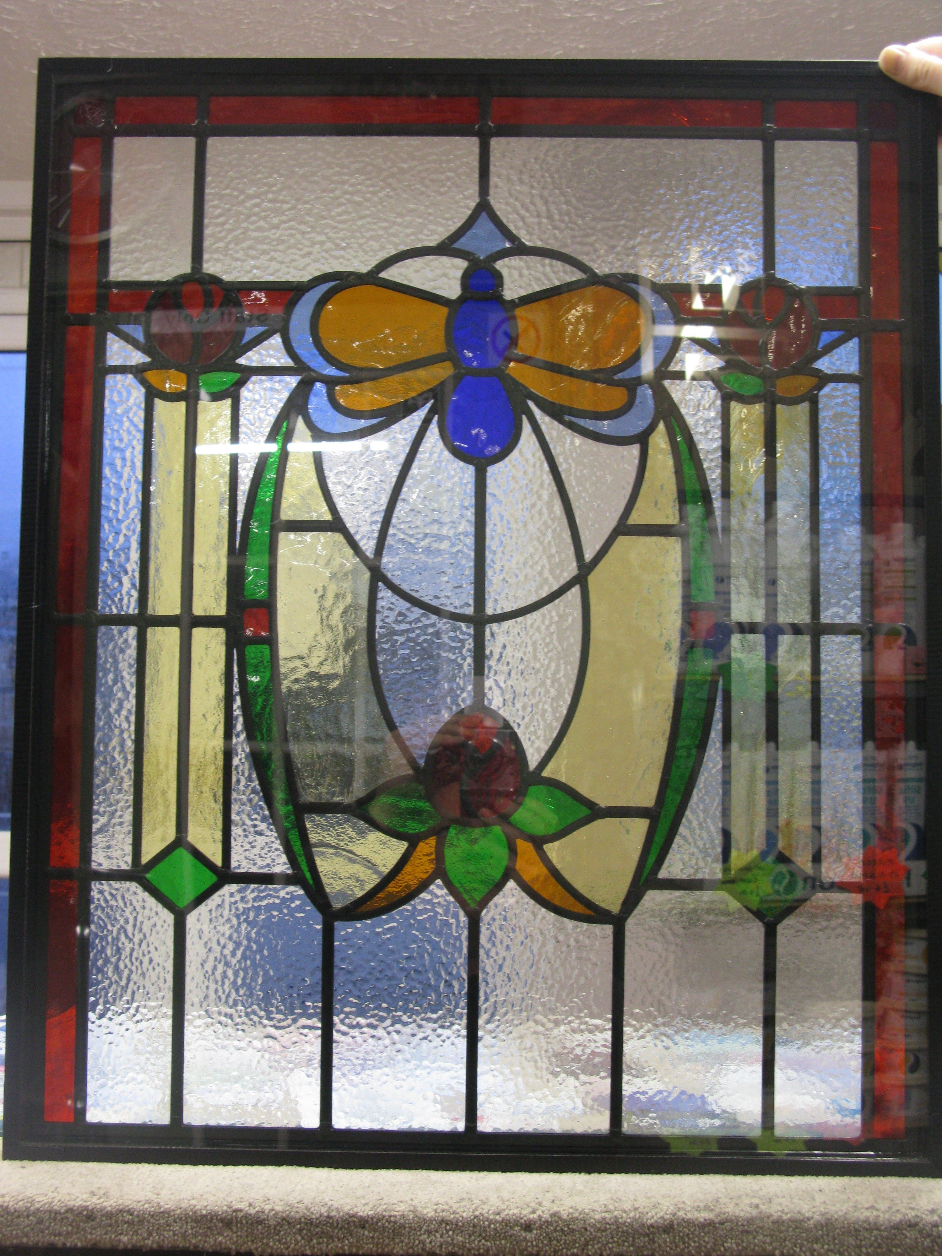 floral stained glass door panel with insect design