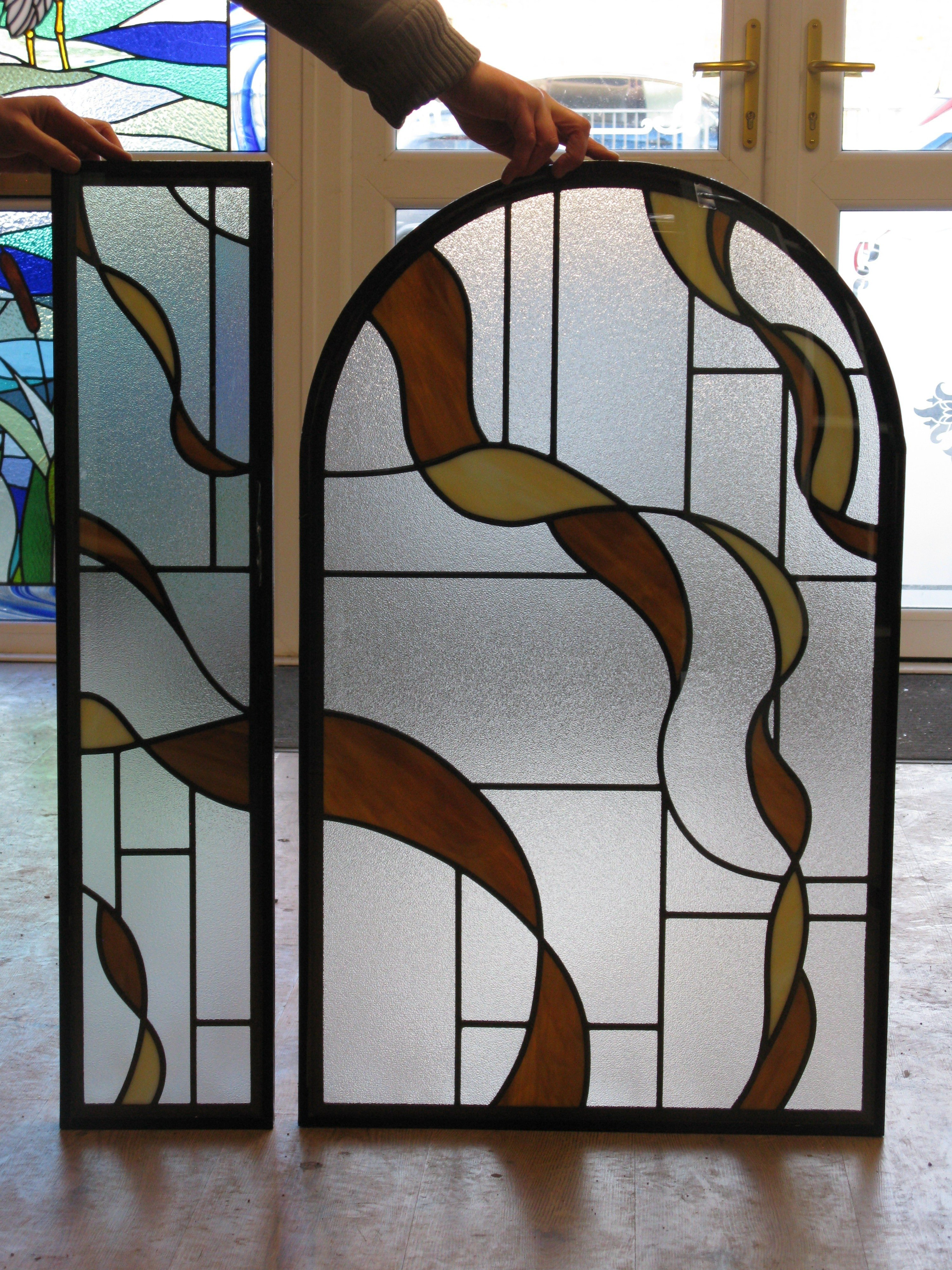 brown and creme coloured stained glass door panel