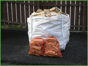 Stacks of wooden logs for sale, perfect for log burners