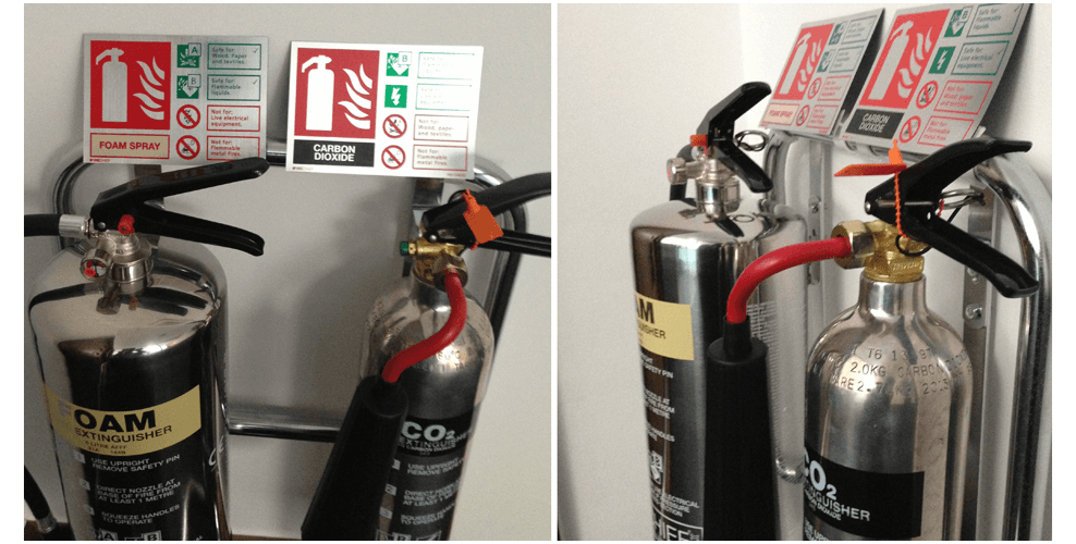 A fire extinguisher mounted on a wall, and installed by City Fire Protection of Gloucester