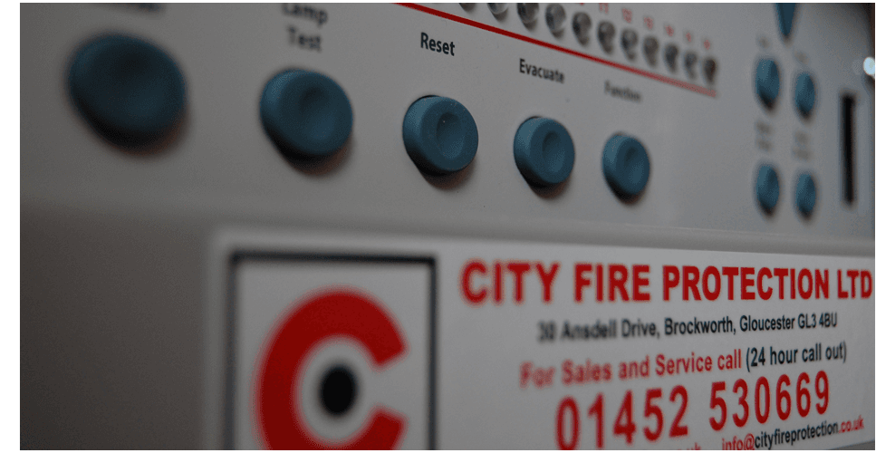 A smoke alarm, installed by City Fire Protection of Gloucester