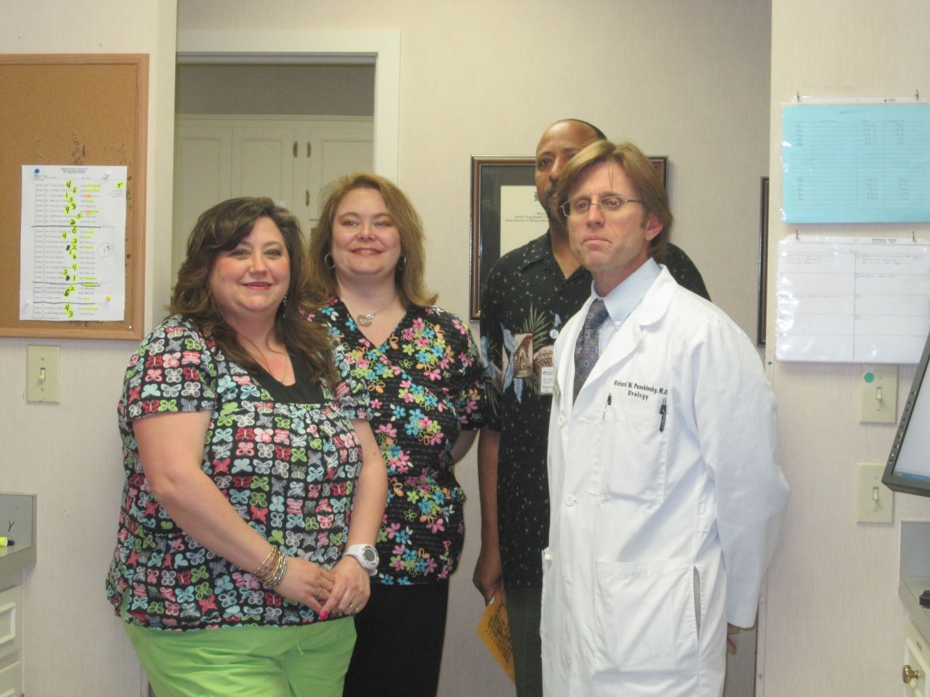 posing with the urological practice team in High Point, NC