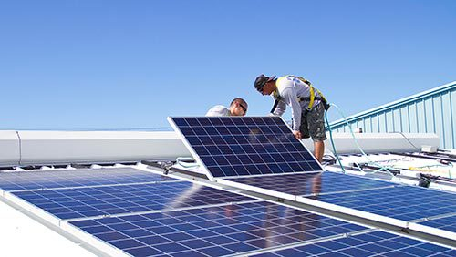 View of the solar panels being installed by solar contractors in Kailua-Kona, HI