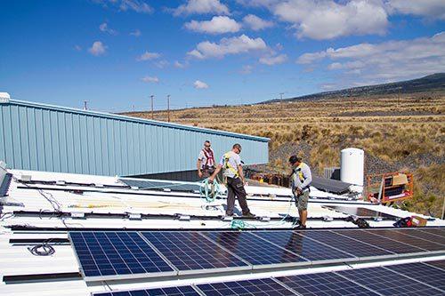 Hired solar contractors installing solar panel in Kailua-Kona, HI