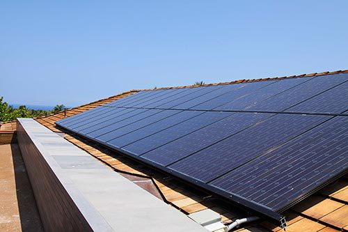 Solar electrical contractor installing solar panels in Kailua-Kona, HI
