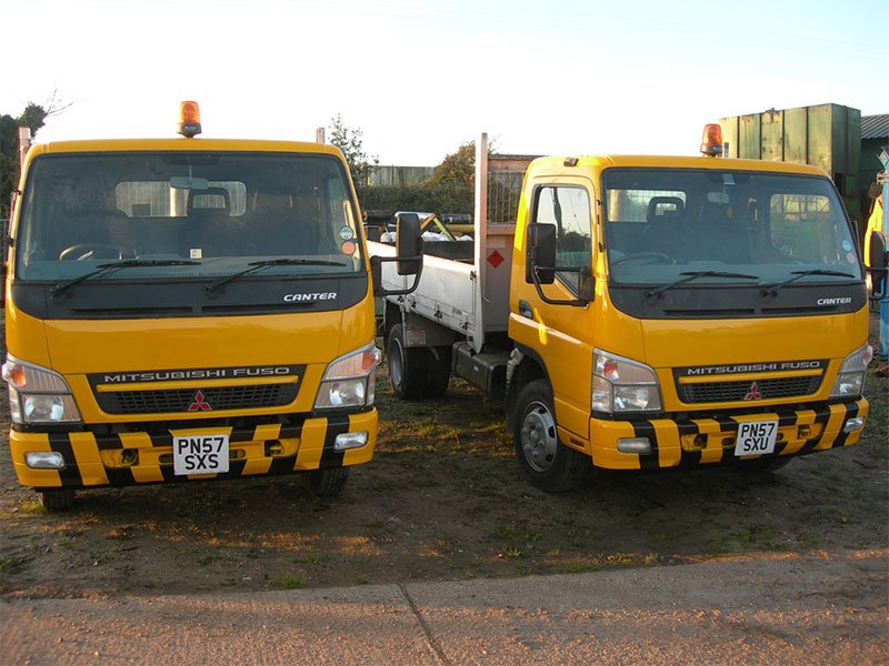 2 yellow trucks