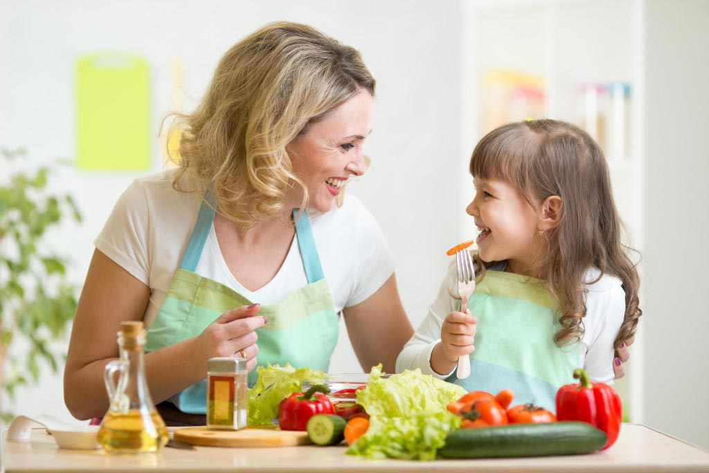mother and daughter making a healthy meal