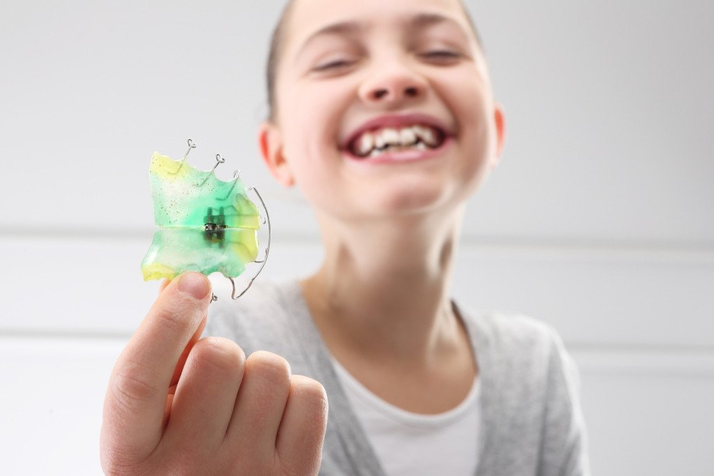 child with orthodontic device