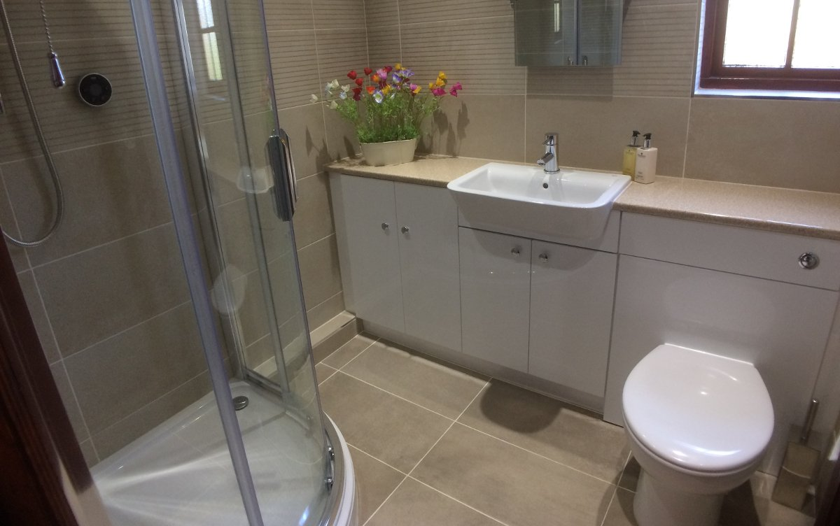 white bathroom suite with shower