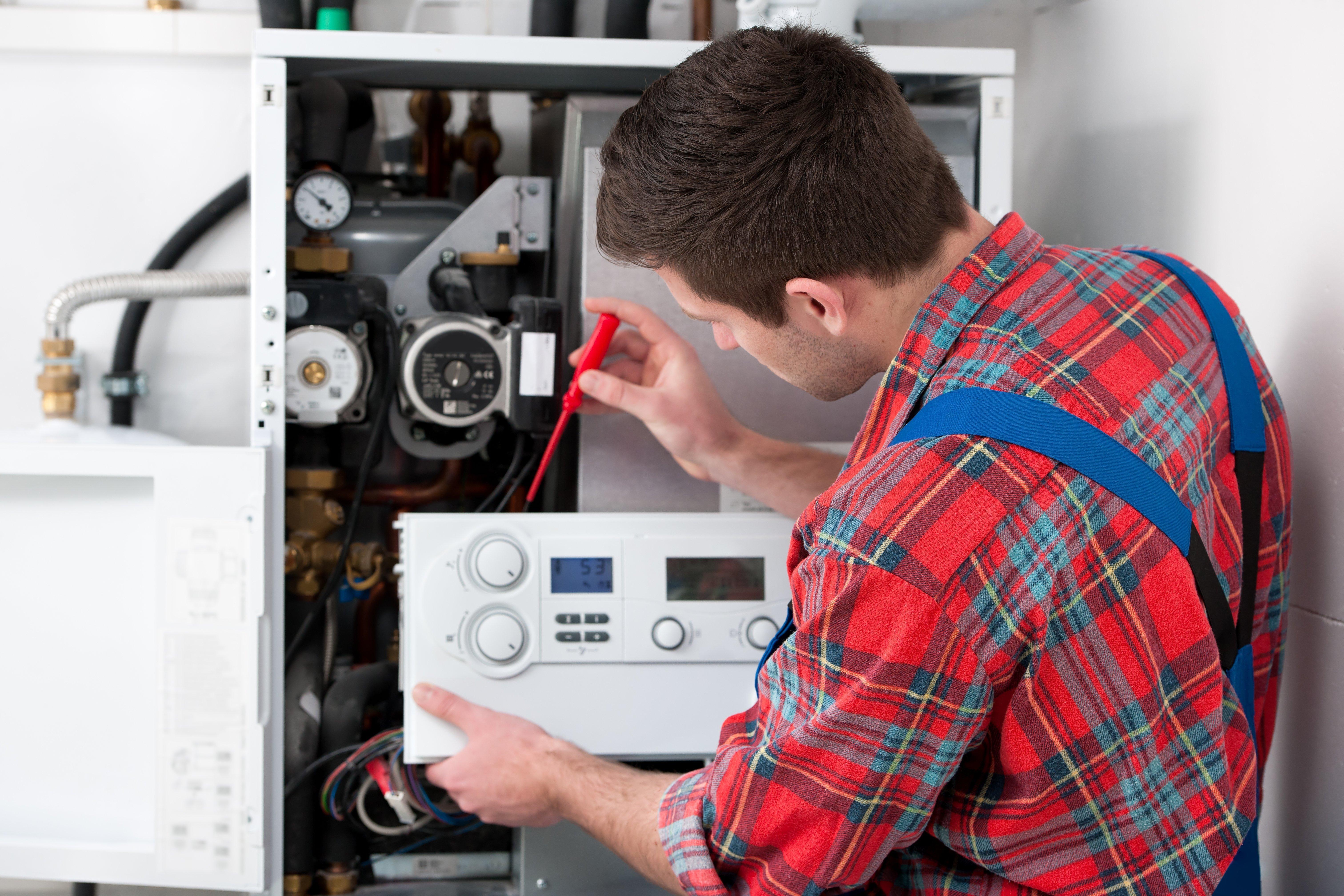 engineer repairing a boiler
