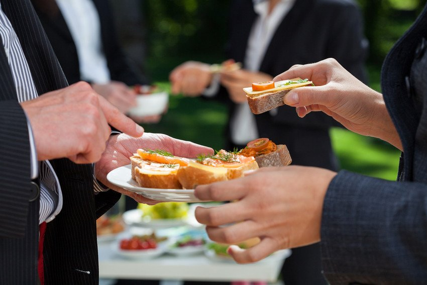 people at event with food