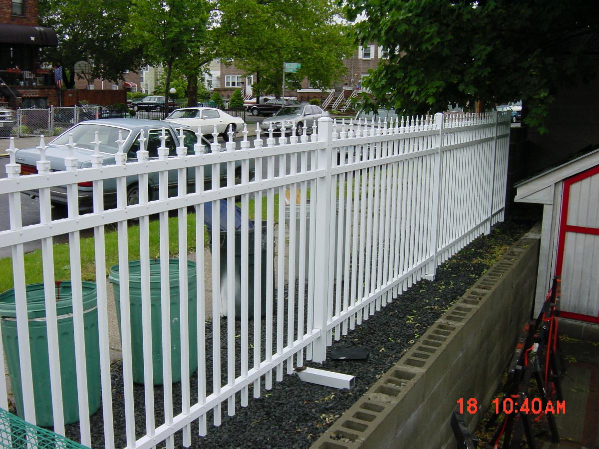 White Wrought Iron Fence Installation For Garden Area In Brooklyn Ny