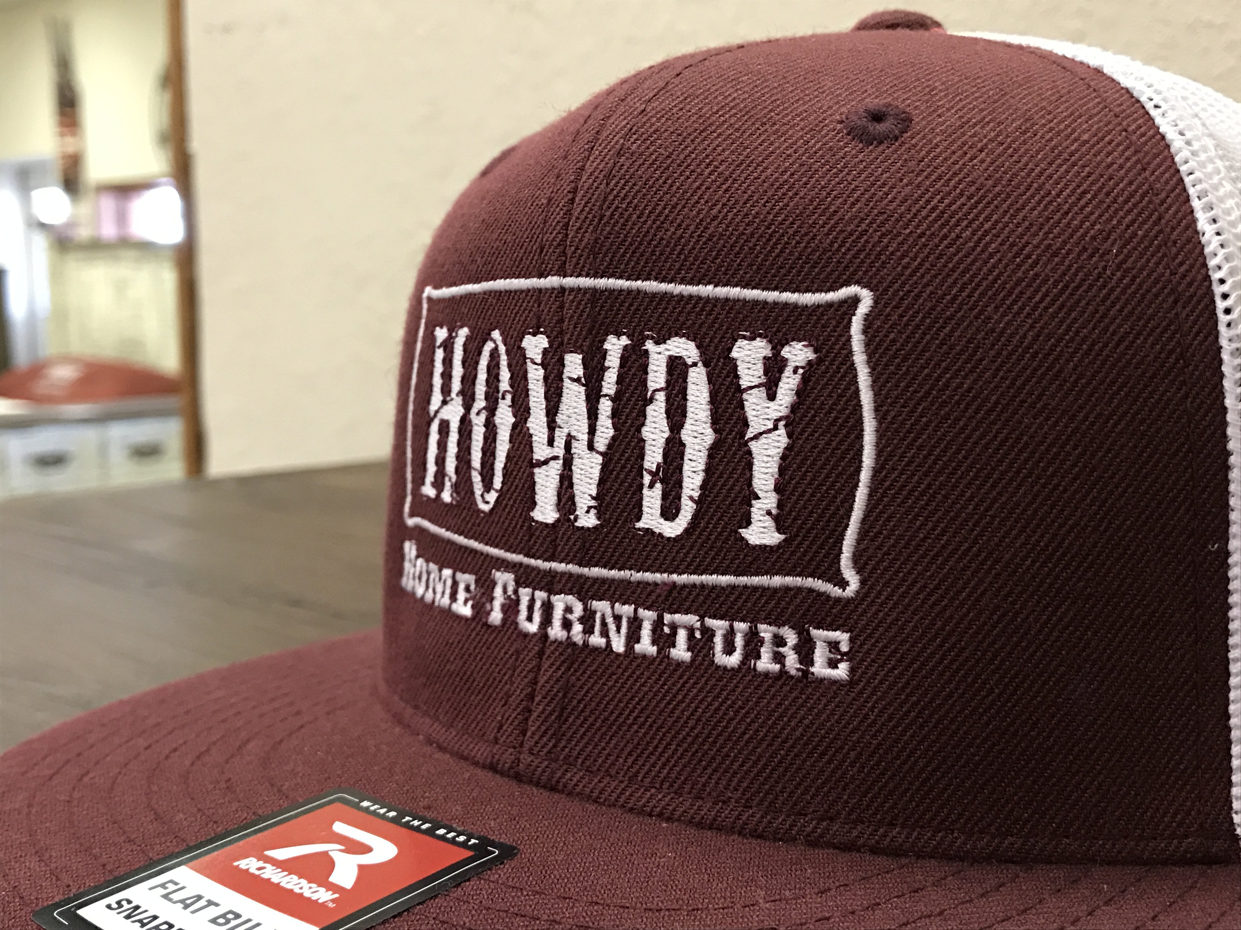 Howdy Home Furniture Hat and Logo
