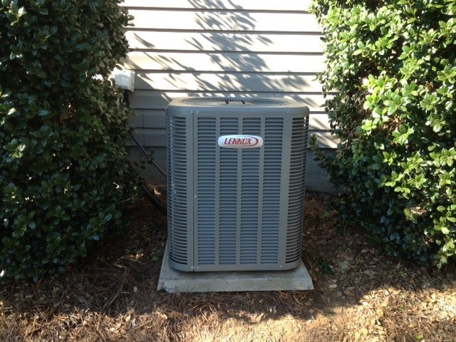 Outside unit after AC repairs in Concord, NC