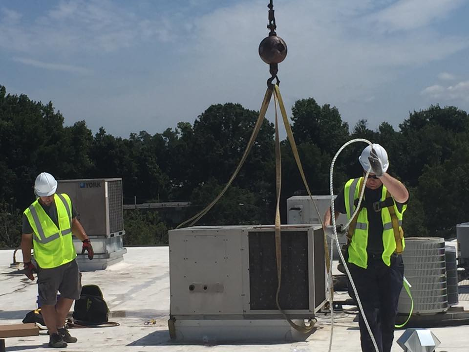 two men working on air conditioning installation in Charlotte, NC