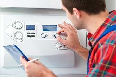 Technician servicing the gas boiler