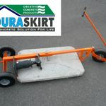 The Duraskirt Seismic Retrofit Cart is shown here with a magnum block by Foundation Works.  When Re-leveling a mobile home the cart makes it easy for retrofitting.