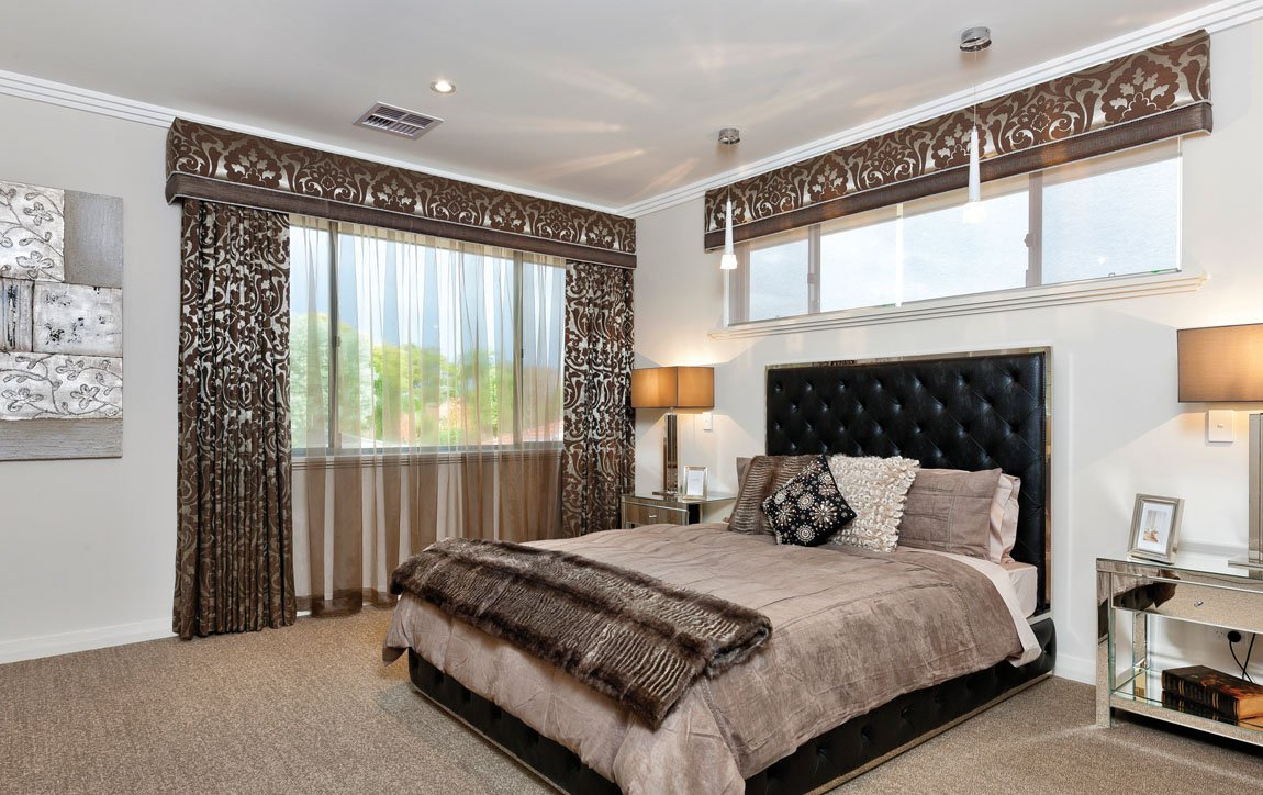 black bed with brown bedspreads