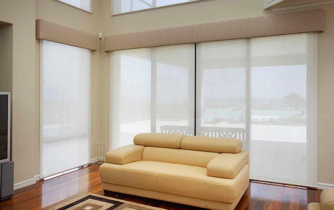 white blinds behind yellow couch