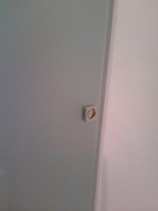 particolare maniglia porta scorrevole