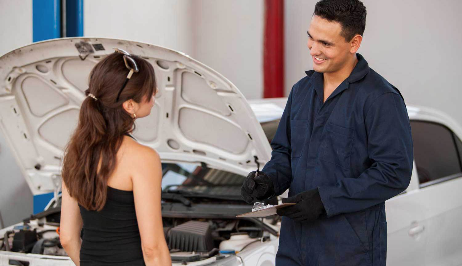 Mechanic with a happy customer