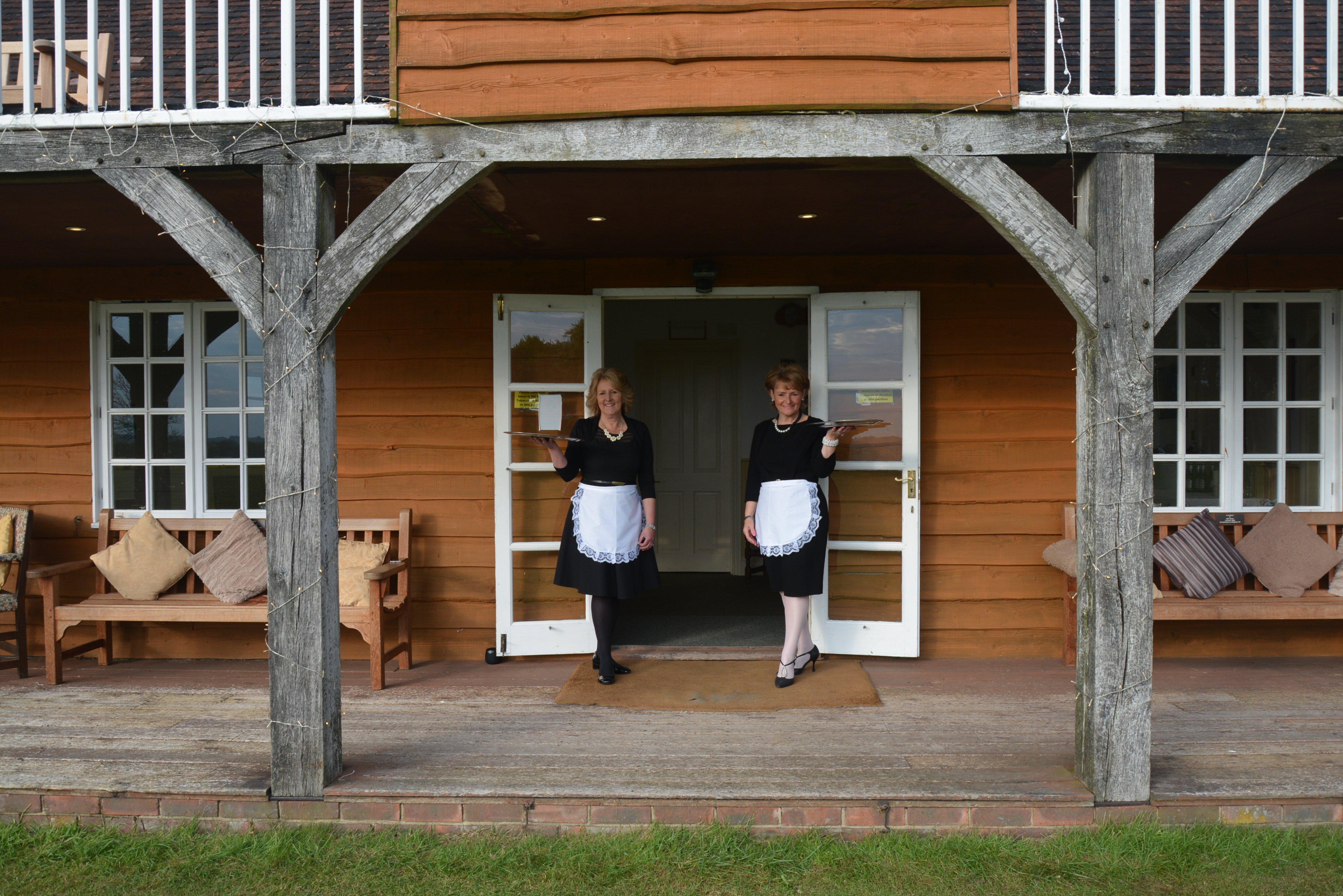 2 waitresses outside the pavilion