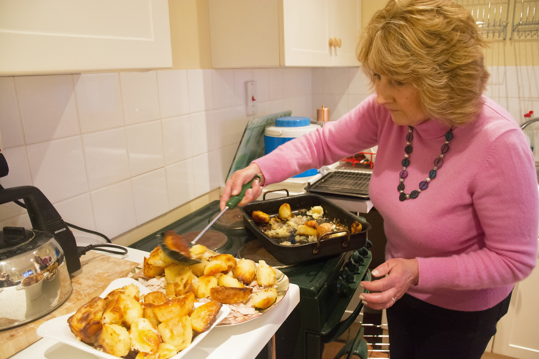 lady cooking roast dinner