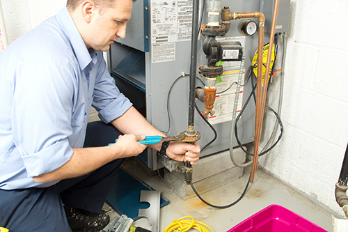 Specialist repairing the furnace in Wisconsin Rapids, WI