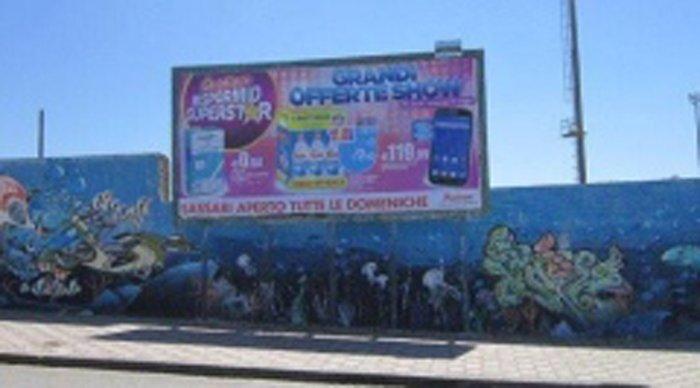 Cartellone pubblicitaria presso Stadio a Ittiri