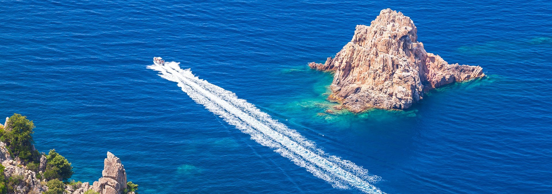Aerial view of individual using a boat in ocean water