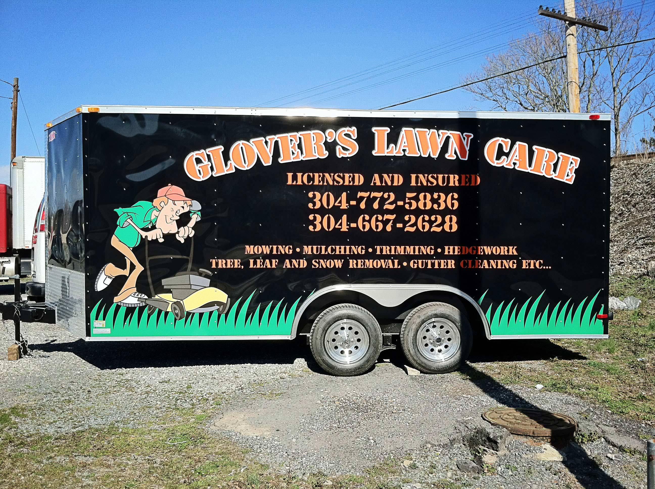 Business logo and banner displayed on a company's vehicle in Covington, VA