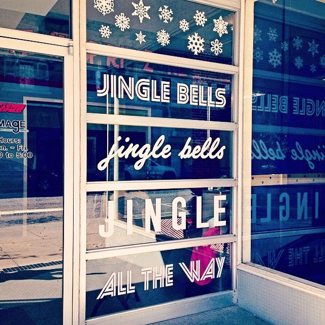 Jingle bells' sign on a glass in different fonts in Covington, VA
