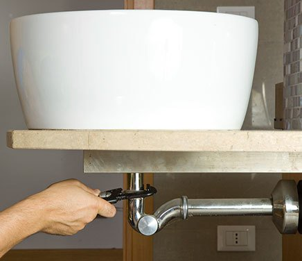 man providing bathroom installation services