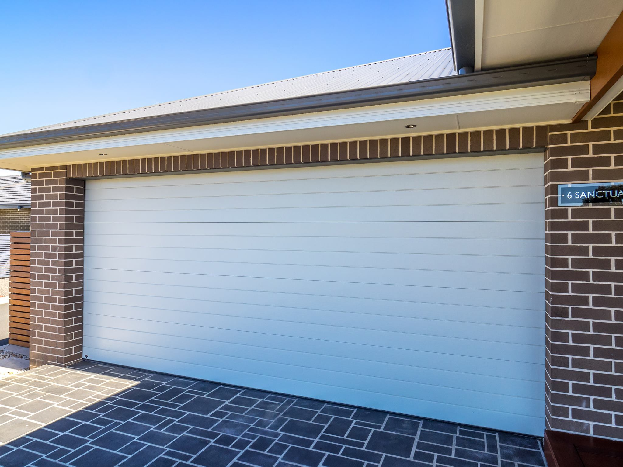Our gallery garage doors and more bd panelift seville in surfmist rubansaba