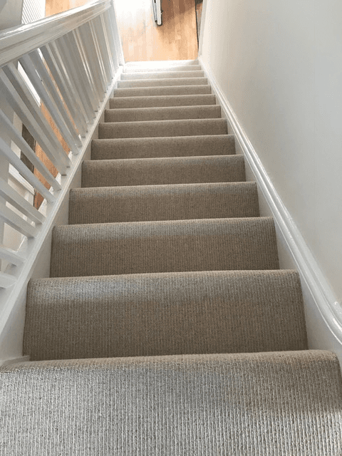 neatly fitted stair carpets