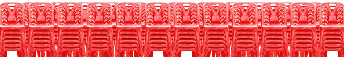 stacks of red plastic chairs