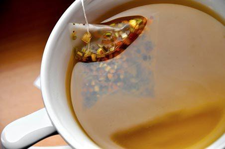 Close up of white mug with premium tea