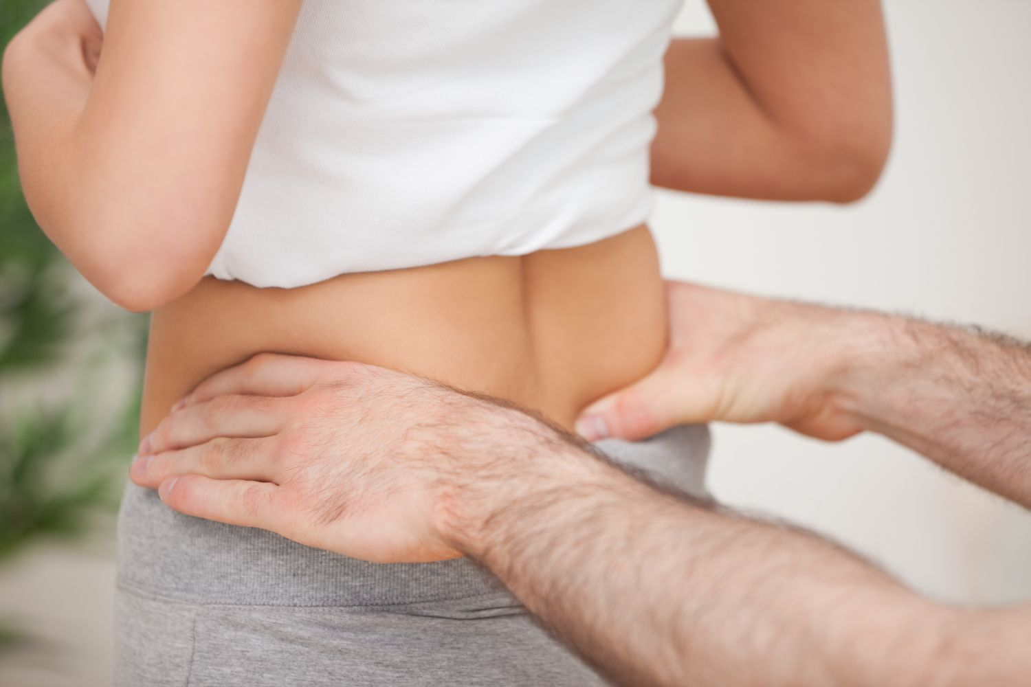 Chiropractor works with a patient for neck pain relief in Honolulu, HI