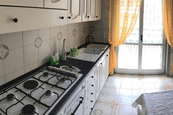 camere con cucina e terrazza