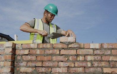 man laying bricks