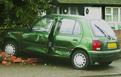 crashed car into brick wall
